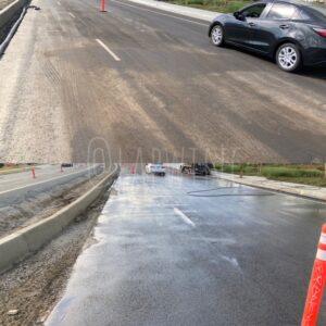 Pressure washed before and after asphalt